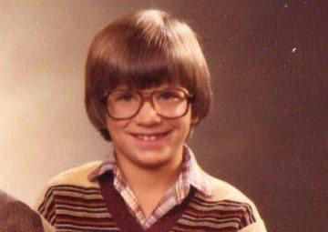An old photo of an awkward early teen JMG