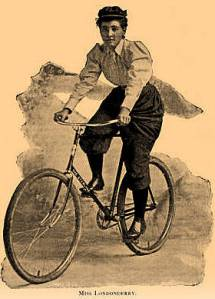 A photo of Annie in her biking attire riding on a bike.